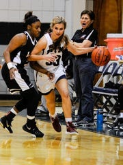 St. Thomas More's Grace Barrilleaux takes the ball up the court against Northside on Friday.