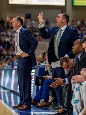 New FGCU coach Michael Fly (with right hand raised) will lead his first Eagles practices during the Summer B session that starts next week.