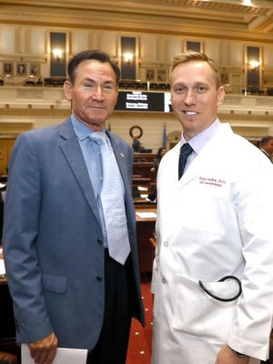 Sen. Ron Sharp (left), R-Shawnee, poses with Dr. Arlen R. Foulks (right), of Choctaw, who served as Doctor of the Day for the Senate on Monday, Mar. 9, 2020.
