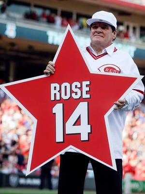FILE -In this June 24, 2016, file photo, former Cincinnati Reds player Pete Rose (14) holds his place marker during a ceremony to honor the 1976 World Series champion team, before the Reds' baseball game against the San Diego Padres in Cincinnati. Rose once again asked Major League Baseball to end his lifetime ban, saying the penalty is unfair compared with discipline for steroids use and electronic sign stealing. Rose's lawyers submitted the application Wednesday, Feb. 5, 2020, to baseball Commissioner Rob Manfred, who in December 2015 denied the previous request by the career hits leader.