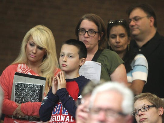 People wait for their turn to speak at an Oct. 28 forum on Common Core standards at Port Chester Middle School.