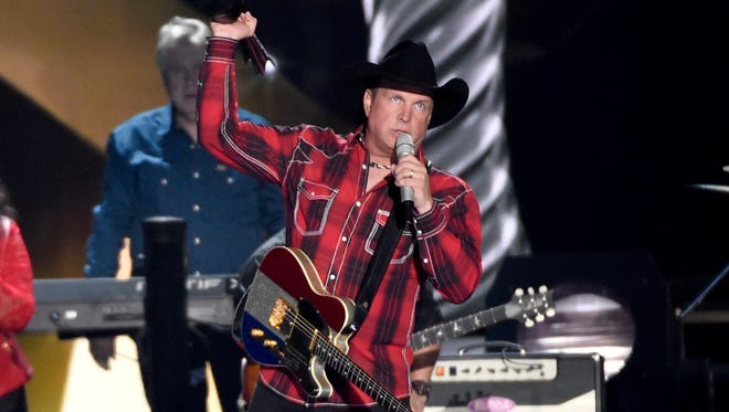 Garth Brooks accepts the milestone award at the 50th annual Academy of Country Music Awards at AT&T Stadium on Sunday, April 19, 2015, in Arlington, Texas.