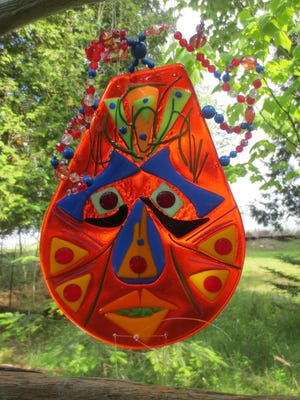 Glass art mask by Penelope Brown, who is taking part in the Lily Bay Lakeshore Artisans open house from July 8 to 10.