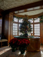 The Belvidere Garden Club has decorated the Governor's Studywith a simple, yet elegant traditional holiday décor.
