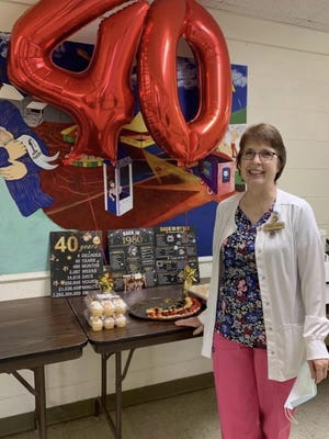 Catie Vosburgh recently celebrated her 40 th anniversary as a registered nurse at Hillcrest Home, outside of Geneseo.