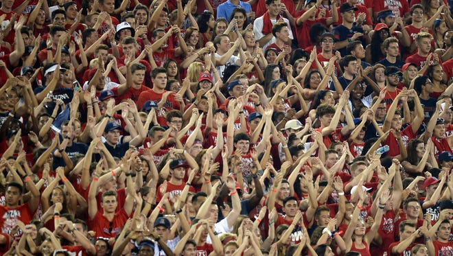 Arizona Wildcats fans cheer during a 2017 game at Arizona Stadium in Tucson.