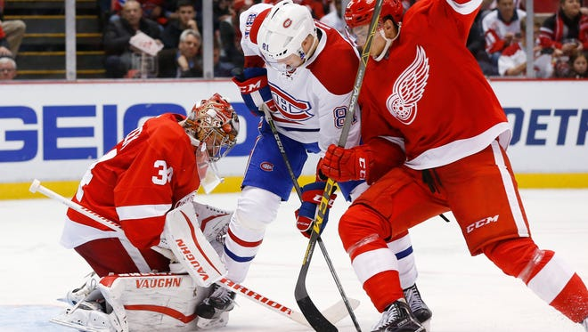 Detroit Red Wings goalie Petr Mrazek, left, stops a shot as Montreal Canadiens center Lars Eller, center, tries for a rebound Dec. 10, 2015, in Detroit.