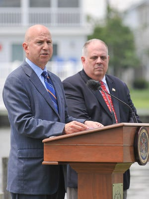 Delaware Gov. Jack Markell (left) and Maryland Gov. Larry Hogan speak on Wednesday in Fenwick Island about the Artificial Island power transmission project. The Delaware Public Advocate's Office estimates the line cost could increase residential electricity bills by $13 a month.