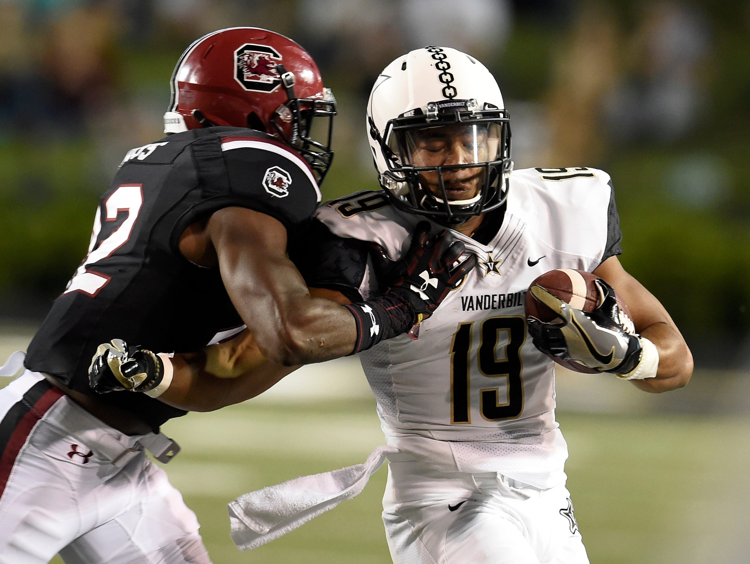 Vanderbilt wide receiver C.J. Duncan (19) tries to move the ball in the first quarter against South Carolina defensive back Jordan Diggs (42) on Sept. 1, 2016.