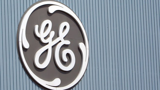 The General Electric logo is seen at a plant in Belfort, eastern France.