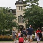 Family and friends help their loved ones during Monmouth University's move-in day in 2013.