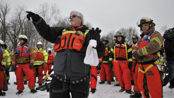 First responders from around Minnesota listen to training from Carl Oskins, president of Dowcar Environmental Management, a New Mexico company that provides oil spill response training.
