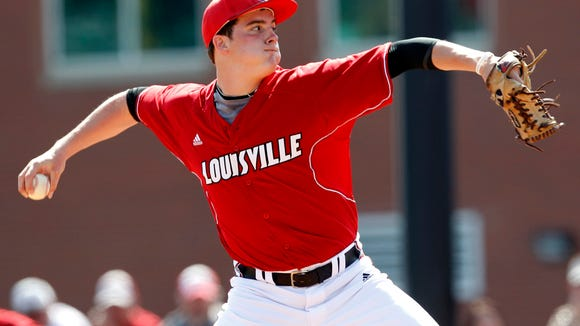 University of Louisville starting pitcher Nick Burdi (19) delivers a pitch to Ole Miss University during their game at Jim Patterson Stadium in Louisville, Kentucky.       March 14, 2012