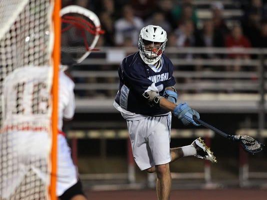 Manheim Twp.'s Davis Carr (2) shoots and scores against Hempfield during second half action at Hempfield High School Tuesday April 28, 2015. Chris Knight - GametimePa.com