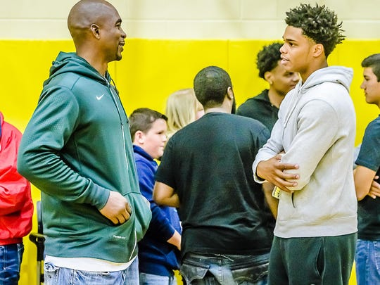 Miles Bridges, right, talks with former MSU player and fellow Flint native Antonio Smith on Saturday at Mott Community College. Bridges returned to Flint to announce he would, like Smith 20 years earlier, become a Spartan.