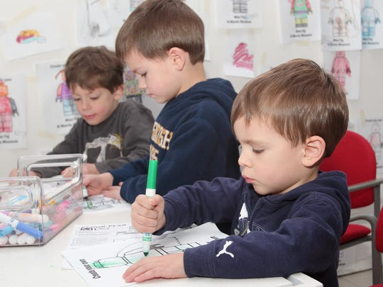 """Villanueva brothers (l-r) Matthew, 7, Tyler, 5, and Nathan, 3, get creative at the """"Create Your Own Mini Fig"""" at the Morris Museum in Morris Twp, NJ, on Saturday, January 17, 2015."""