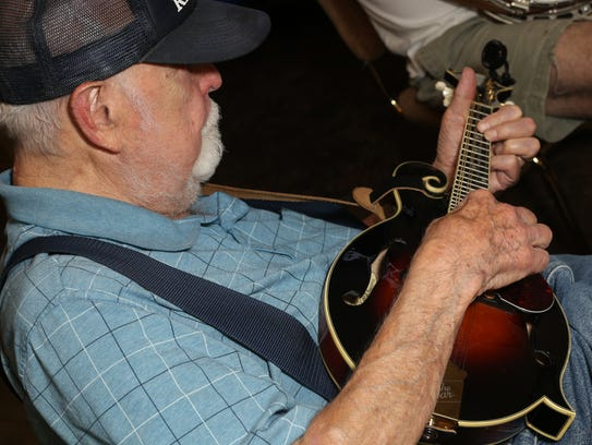 Bert Hudson takes part in a jam session at the VFW