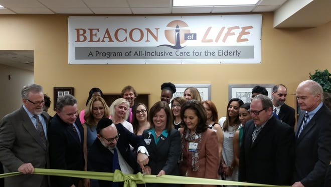 U.S. Rep. Chris Smith (R-N.J.), Freeholder John Curley, AcuteCare Health Systems President Dan Czermak and Beacon of Life Executive Director Sue Skola cut the ribbon on the new PACE facility at the former Patterson Army Clinic on October 15, 2015