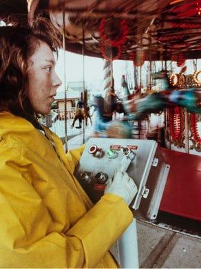 Undated: Heidi-Lynn Conoly 17,  operates the carousel.