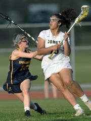 Rush-Henrietta's Gabby Garrett, right, is defended by Spencerport's Jamie Briggs during a regular season game at Rush-Henrietta High School on Wednesday, May 9, 2018. Rush-Henrietta beat Spencerport 18-9.
