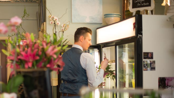 Curtis John Heatherman, Jr., 28, of Brockport owns the floral shop Curtis John, which is located inside of the Red Bird Cafe in the village of Brockport.