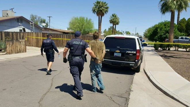 Tempe police took a man into custody after finding him in a woman's attic.
