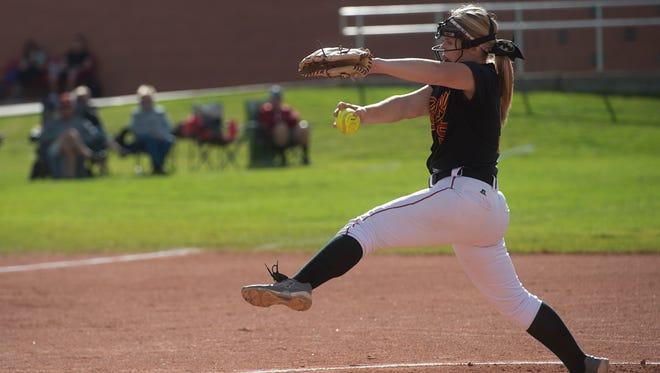Rocky Mountain High School pitcher Kelli Schueler delivers the ball to a Fossil Ridge batter Thursday, September 15, 2016.