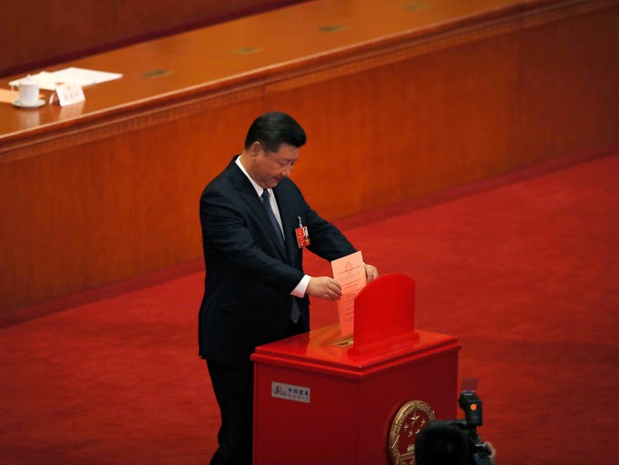 Chinese President Xi Jinping casts his vote for an