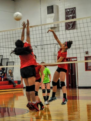 Lady Grizzly Joana Vega slams the ball over the net in the Class 1A District 4 championship match with Quemado Nov. 4 in Carrizozo.