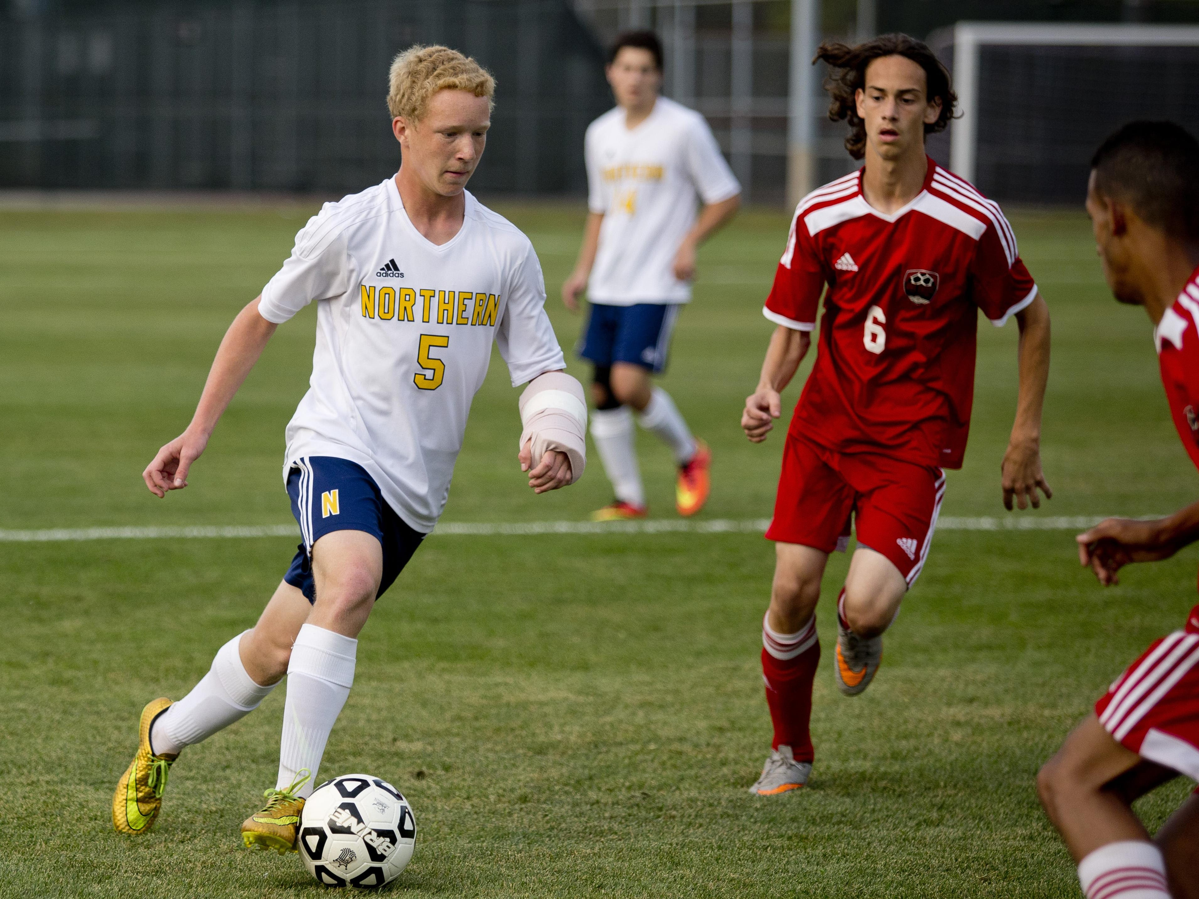 Port Huron Northern Jake Schroll works the ball down field during a soccer game Thursday, September 24, 2015 at Port Huron Northern High School.