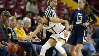 ASU freshman guard Reili Richardson chases a loose ball during a win over Oral Roberts.