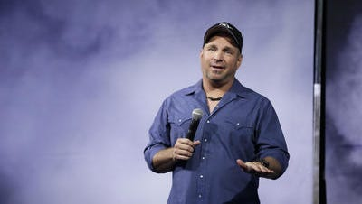 Garth Brooks talks at his Nashville press conference announcing plans for new album and tour in July.