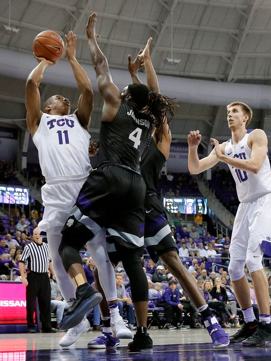In this March 1, 2017 photo, TCU's Brandon Parrish (11) attempts a shot over Kansas State' D.J. Johnson (4) as Vladimir Brodziansky (10) of Slovakia watches during an NCAA college basketball game in Fort Worth, Texas. A week into February, TCU had just pulled out a one-point victory at home and had already won six Big 12 games under new coach Dixon. (AP Photo/Tony Gutierrez)