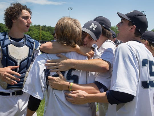 Manasquan pitcher Connor Muly gets hugs from team mates as they celebrate their state championship. Manasquan vs Whipping Park in NJSIAA Group II Baseball Championship in Toms River, NJ on June 10, 2017.