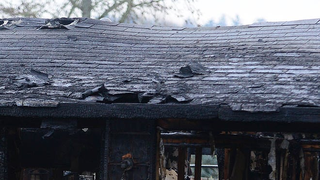 "The aftermath of a house fire in Jefferson. Officials said the house is a ""total loss."""