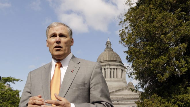 Washington Gov. Jay Inslee talks to the media on April 22, 2015, in Olympia, Washington.