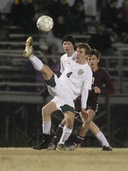 Lincoln's Rigel Aucutt tries to play a ball in the