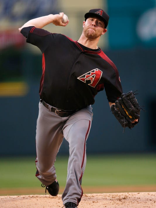 Arizona Diamondbacks' Archie Bradley delivers a pitch to a Colorado Rockies batter during the first inning of a baseball game Friday, June 24, 2016, in Denver. (AP Photo/David Zalubowski)