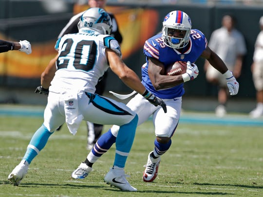 Buffalo Bills' LeSean McCoy (25) runs as Carolina Panthers' Kurt Coleman (20) defends in the second half of an NFL football game in Charlotte, N.C., Sunday, Sept. 17, 2017. (AP Photo/Bob Leverone)