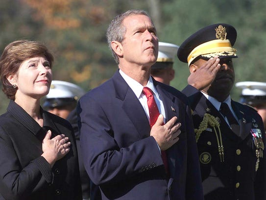 President George W. Bush, along with first lady Laura