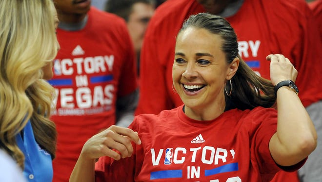 San Antonio Spurs head coach Becky Hammon smiles as she prepares for a post-game interview after defeating Phoenix 93-90 in the NBA Summer League Final at Thomas & Mack Center.