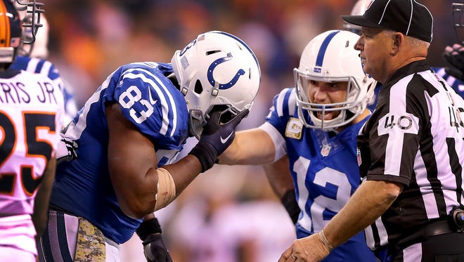 Indianapolis Colts tight end Dwayne Allen (83) holds his hand over his face mask after he was poked in  the eye by Denver Broncos cornerback Aqib Talib late in the fourth quarter of their game.  The Indianapolis Colts defeated the Denver Broncos 27-24 Sunday, November 8, 2015, afternoon at Lucas Oil Stadium.