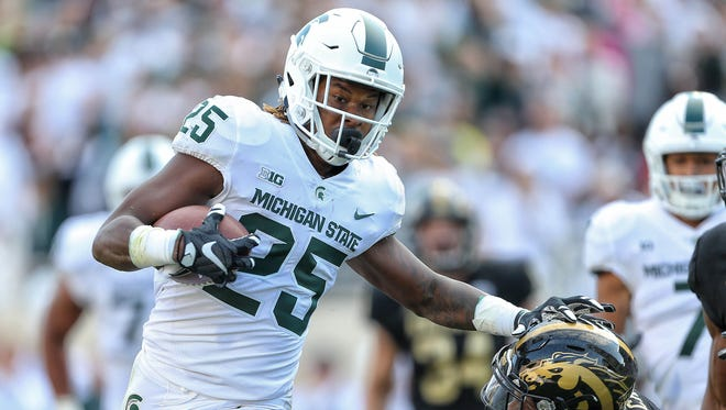 East Lansing, MI, USA; Michigan State Spartans wide receiver Darrell Stewart Jr. (25) stiff arms Western Michigan Broncos defensive back Obbie Jackson (24) during the second half of a game Sept. 9, 2017, at Spartan Stadium in East Lansing.