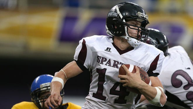 Exira-EHK quarterback Drew Peppers carries the ball against Don Bosco during the state football championship game on Thursday, Nov. 21, 2013, at the UNI-Dome in Cedar Falls. (Bryon Houlgrave/The Des Moines Register)