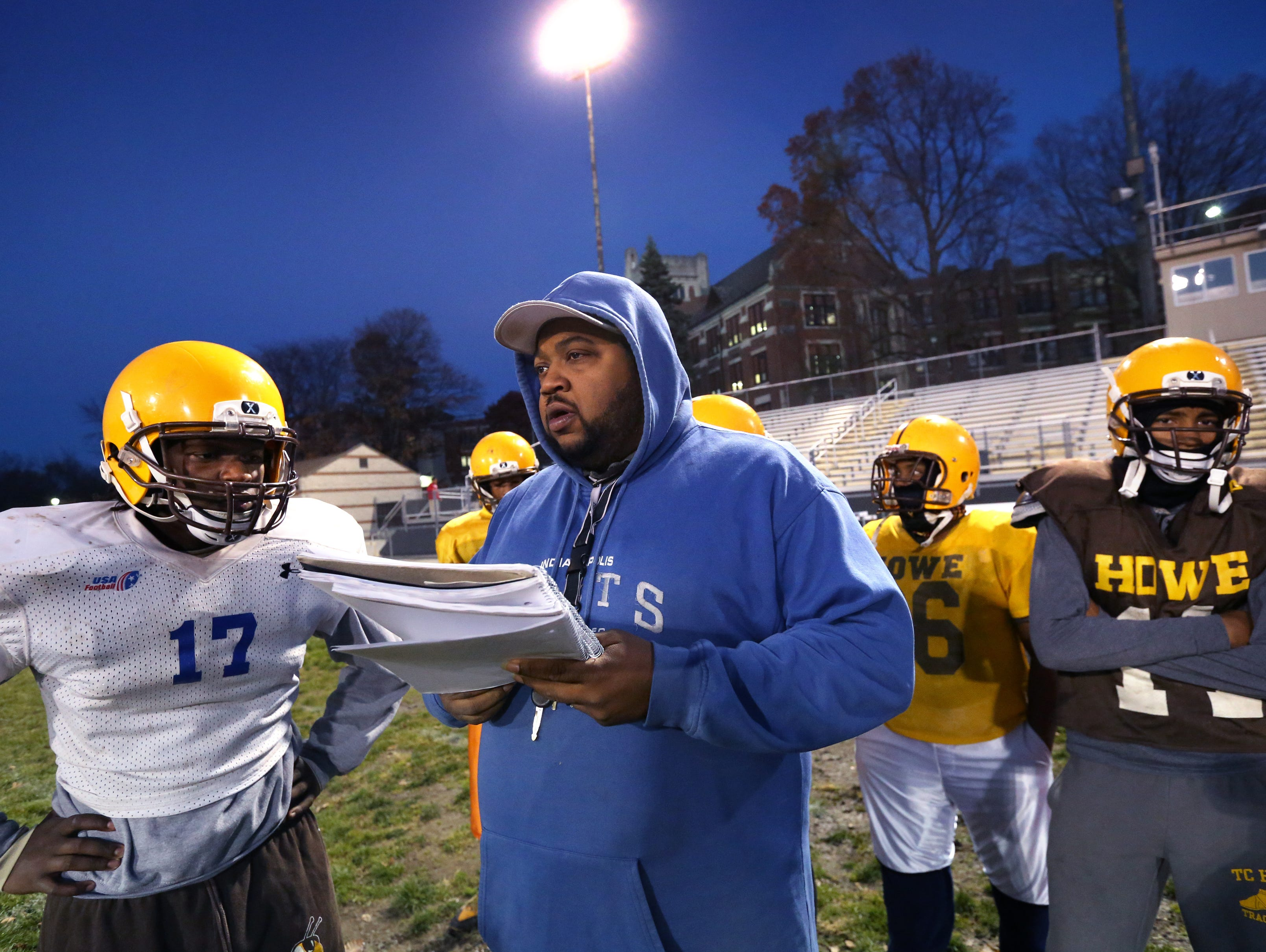 Second-year Howe High School head football coach Craig Chambers outlines a play for senior quarterback Chris Mundy, left, during practice at the school at 4900 Julian Ave., Indianapolis, on Wednesday, Nov. 5, 2014.Second-year Howe High School head football coach Craig Chambers outlines a play for senior quarterback Chris Mundy, left, during practice at the school at 4900 Julian Ave., Indianapolis, on Wednesday, Nov. 5, 2014. After their 20-13 win over the South Decatur Cougars, the Hornets advance to their first sectional championship football game in school history.