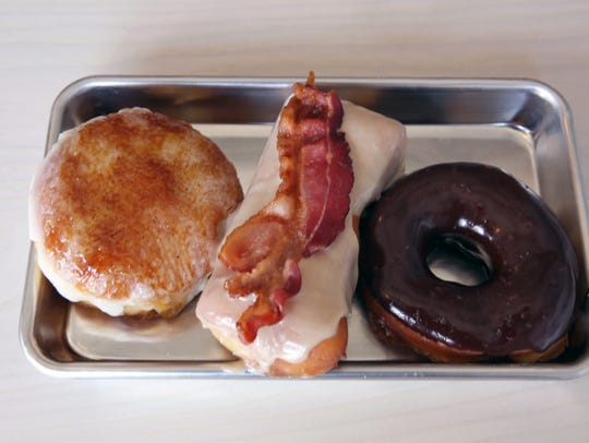 A creme bružlŽee doughnut, a maple bacon doughnut and a chocolate doughnut with sea salt are among the choices at Boxcar, 127 Railroad St.