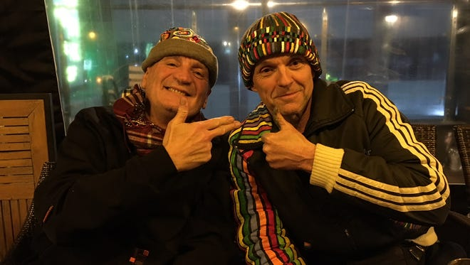 Former Olympians Jean-Blaise Evequoz (left) and Roald Bradstock are bringing art – and highly irreverent humor – to the 2018 Winter Games. Bradstock painted both of those hats, by the way.