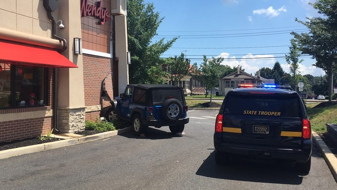 Police are investigating how a Jeep driver ended up crashing into a fast food restaurant near Elsmere.