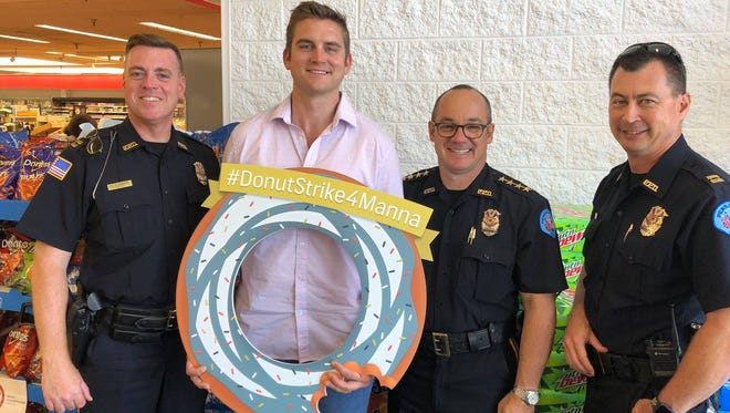 From left, Capt. Stephen Davis, Austin Tenpenny, Chief Tommi Lyter and Capt. Chuck Mallett pose for a photograph during the 2018 Donut Strike 4 Manna campaign in June.