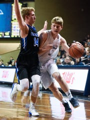 Sioux Valley guard Trevor Olson (4) drives to the basket